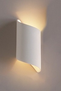 Ceramic wall sconce in a ribbon shape