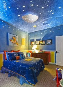 An outer space theme bedroom is perfect for kids with a passion for stars and planets.