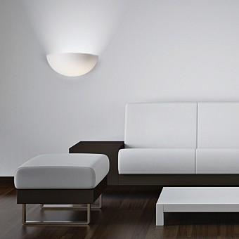A living room with couch and wall sconces