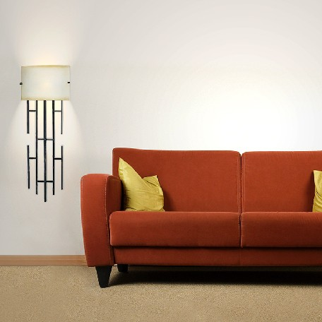 A burnt orange midcentury sofa with two wallchieres.