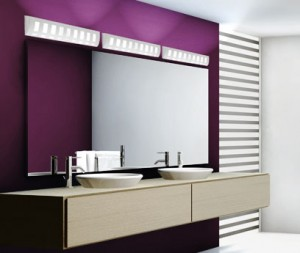 A modern bathroom with purple walls and ceramic vanity lights