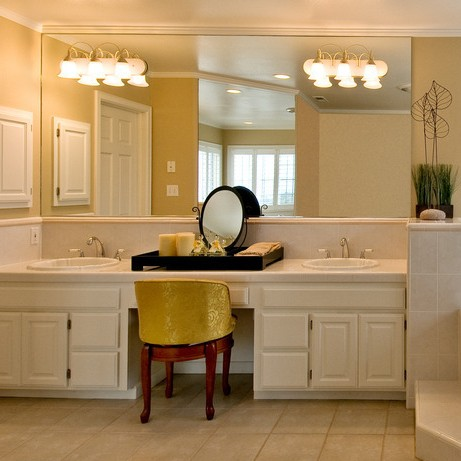 Bathroom with large mirror and vanity lights